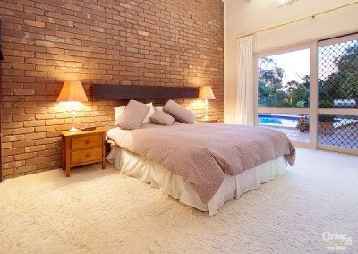 original main bedroom with exposed brick wall